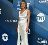 Jennifer Aniston Is Making the '90s Proud in This White Silk Slip Dress